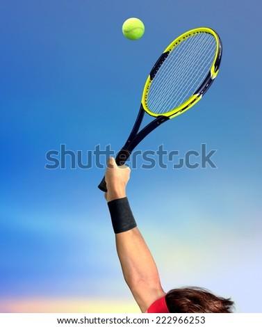 Man Making a Tennis Serve - stock photo