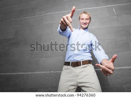 Man making an obscene gesture - stock photo