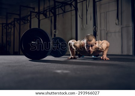 Man making burpees during strength training - stock photo