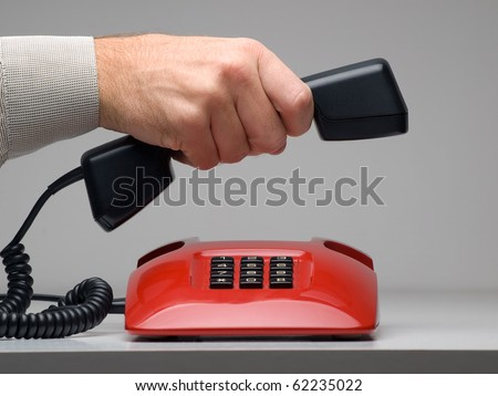 man making or ending the call, for customer services,emergency or other communication related themes - stock photo