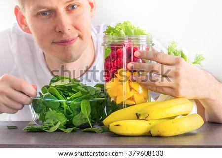 man making smoothie - stock photo