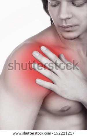 Man massaging shoulder pain isolated on white background - stock photo