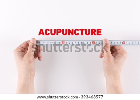 Man measuring ACUPUNCTURE - stock photo