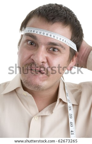 man measuring his head, isolated on white - stock photo