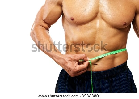 Man measuring his waistline. - stock photo