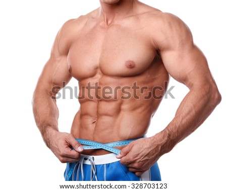 Man measuring his waistline over white background - stock photo