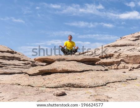 man meditates in nature - stock photo
