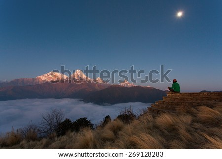 Man meditating in Himalaya Mountains View from Poon Hill 3210m at sunset - stock photo