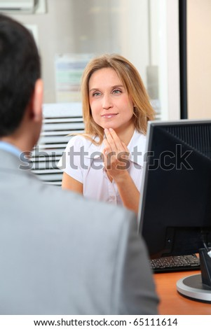 Man meeting financial adviser in office - stock photo