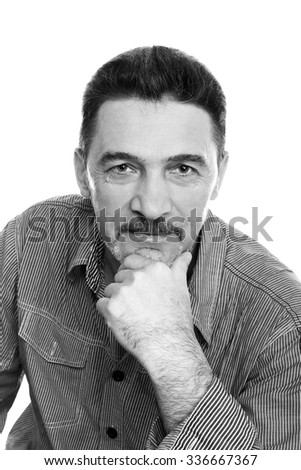 man middle aged gray beard shirt  looking camera black and white - stock photo