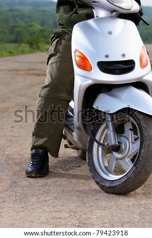 Man motorbiker on the scooter an the outdoor - stock photo