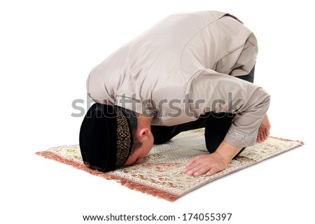 man muslim doing prayer isolated over white background - stock photo