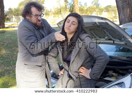 Man not able to believe his girlfriend broke his car - stock photo