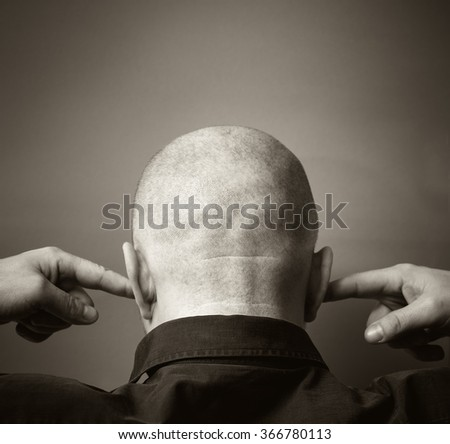 Man of European appearance thirty years his ears fingers.  Black and white photo. - stock photo