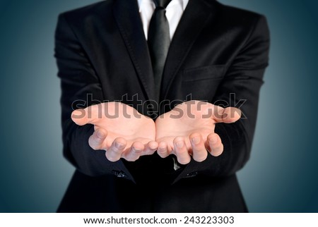 Man offer hand and holding nothing - stock photo