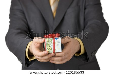 Man offering financial aid in a gift box wrapped in euro banknotes. - stock photo