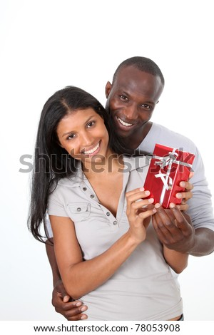 Man offering gift to woman on her birthday - stock photo