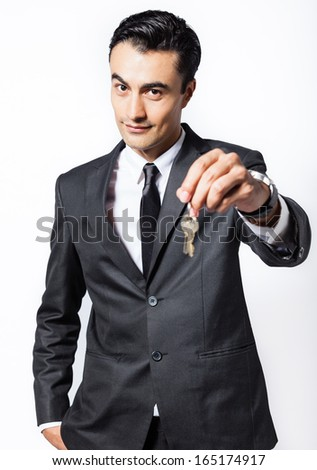 Man offering keys to the new home - stock photo