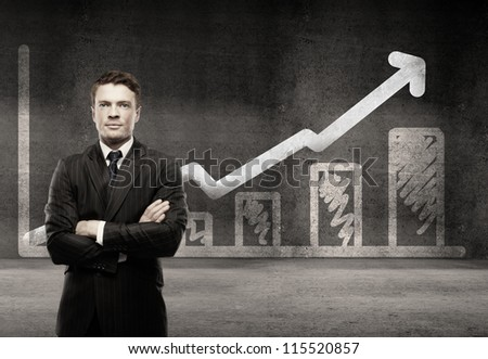 man on a background of growth chart - stock photo
