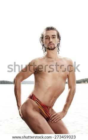 Man on a beach - stock photo