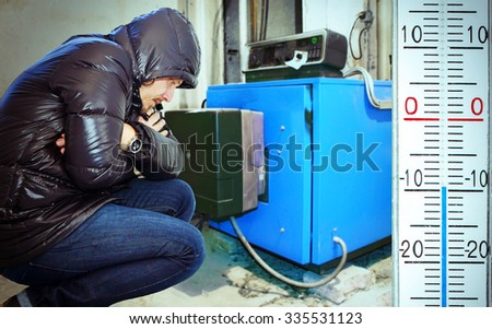 Man on a cold day in the cellar with heating system - stock photo