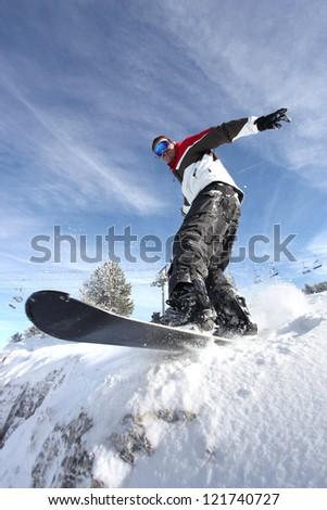 Man on a snowboard - stock photo