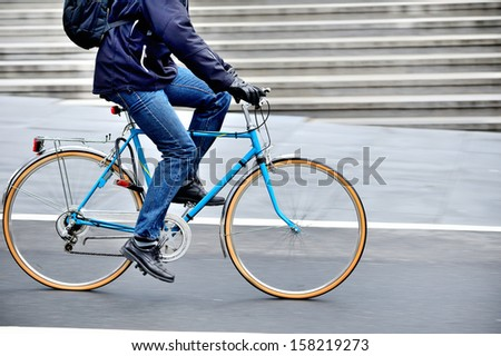 Man on bike in profile - stock photo