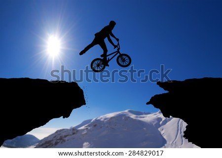 Man on bike jumping silhouette - stock photo