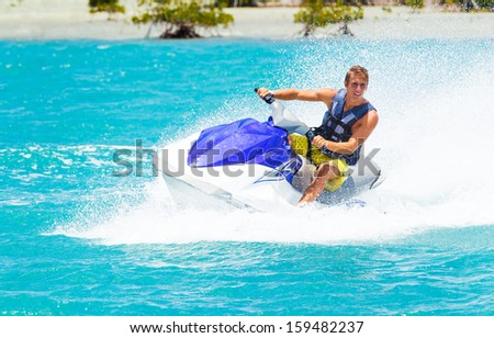 Man on Jet Ski having fun in Ocean - stock photo