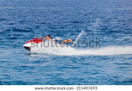 man on jetski jump on the wave - stock photo