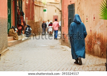 Man on Moroccan market (souk) in Marrakech, Morocco - stock photo