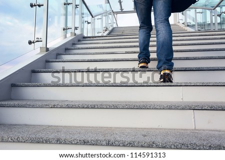 man on office stairs and blue sky - stock photo