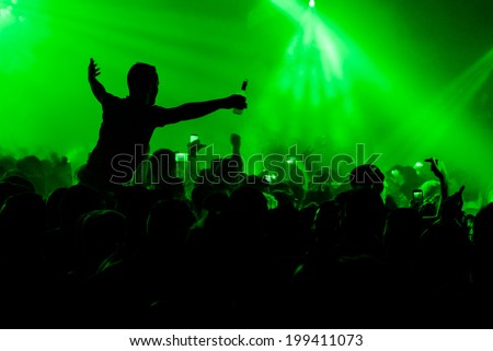 Man on shoulders in nightclub party rave silhouette - stock photo