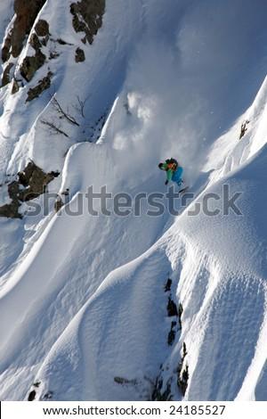 Man on snowboard ride in big mountain - stock photo