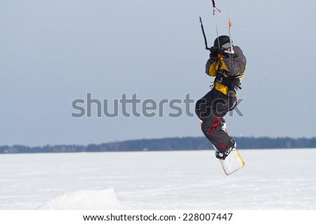 Man on snowkiting in winter - stock photo