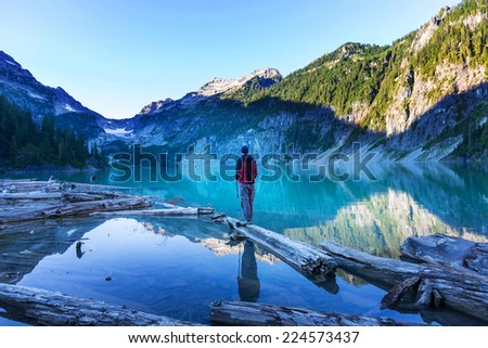 Man on summer lake - stock photo
