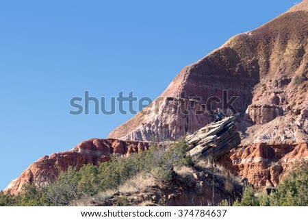 Man on the background Capitol Peak in Palo Duro Canyon State Park, Texas, USA - stock photo