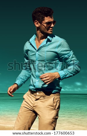 Man on the beach - stock photo