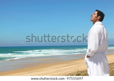man on the beach - stock photo