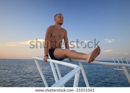 Man on the boat - stock photo