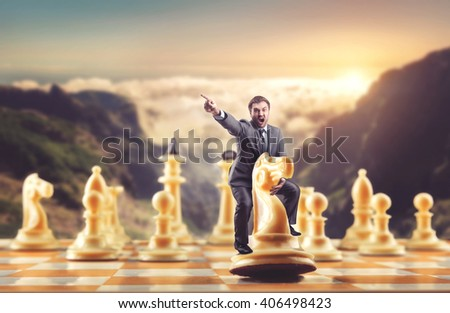 Man on the chess figure - stock photo