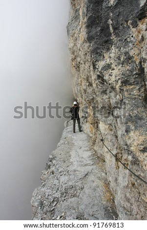 Man on the edge - Via ferrata, Dolomiti di Brenta, Italy - stock photo
