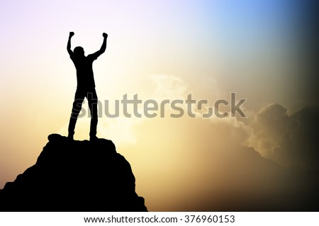 Man on the peak of mountain and sunlight  , success,winner, leader growth vision leadership spring time healthy imagination sky sport outdoor  business  friendship relationship concept - stock photo