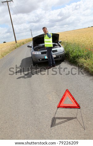 Man on the road with car breakdown - stock photo
