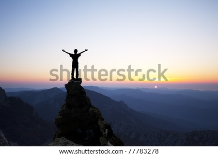 man on the top of a rock - stock photo