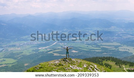 Man on the top of hill - stock photo