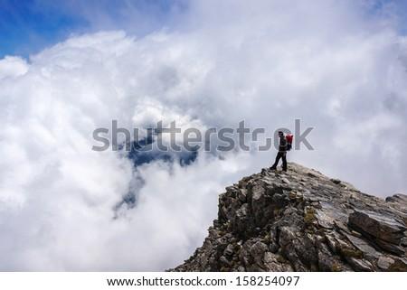 Man on top of mountain. Greece, Mount Olympus. - stock photo