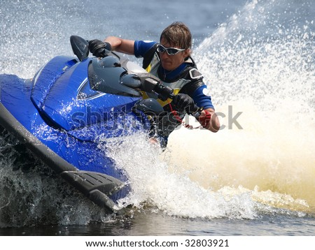 Man on WaveRunner turns very fast - stock photo