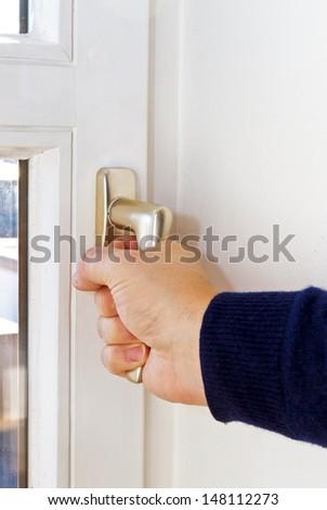 Man open a window - stock photo
