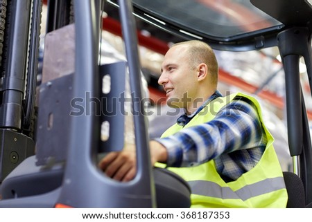 man operating forklift loader at warehouse - stock photo